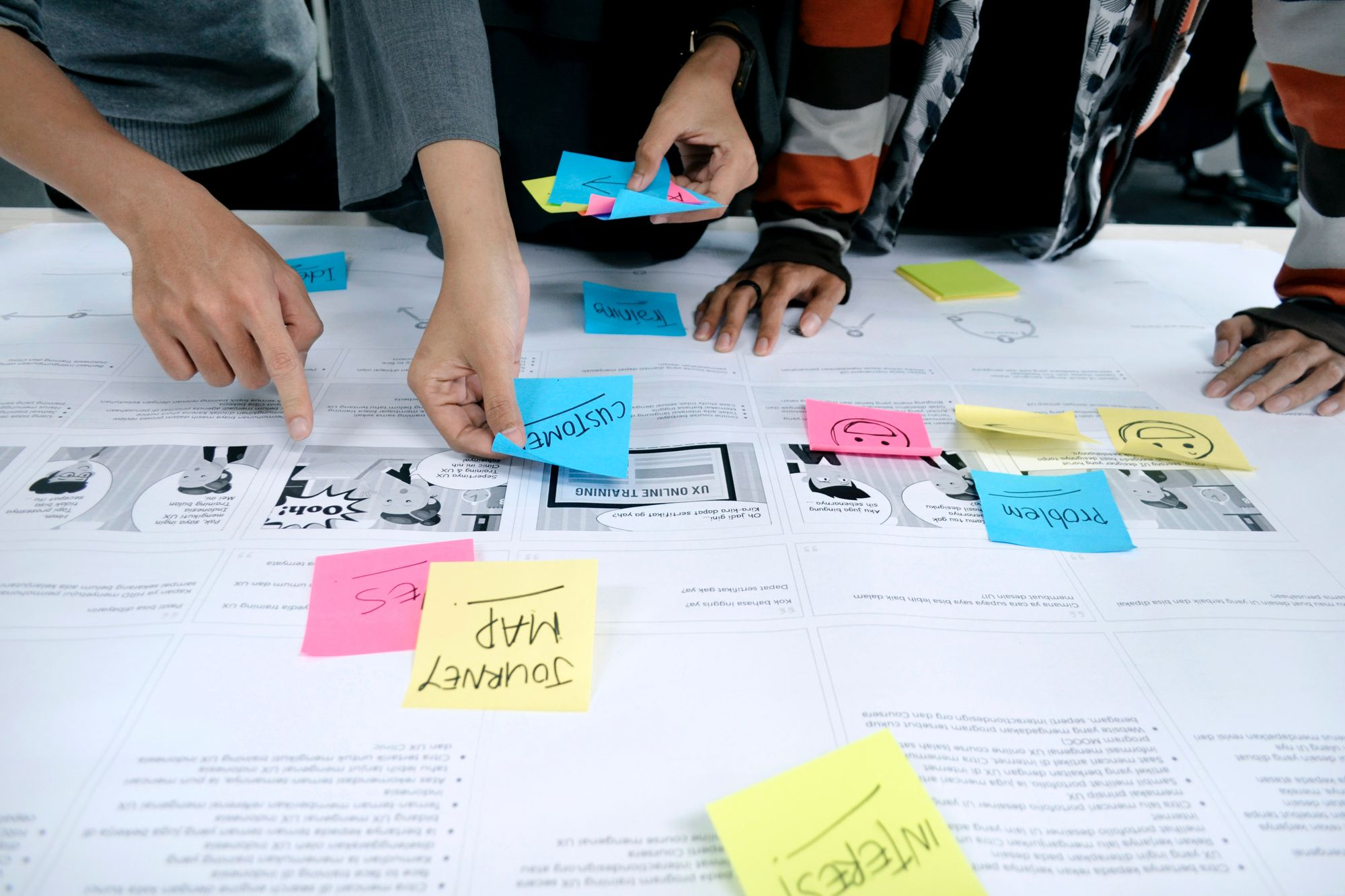 UX Designer using sticky notes for UX research