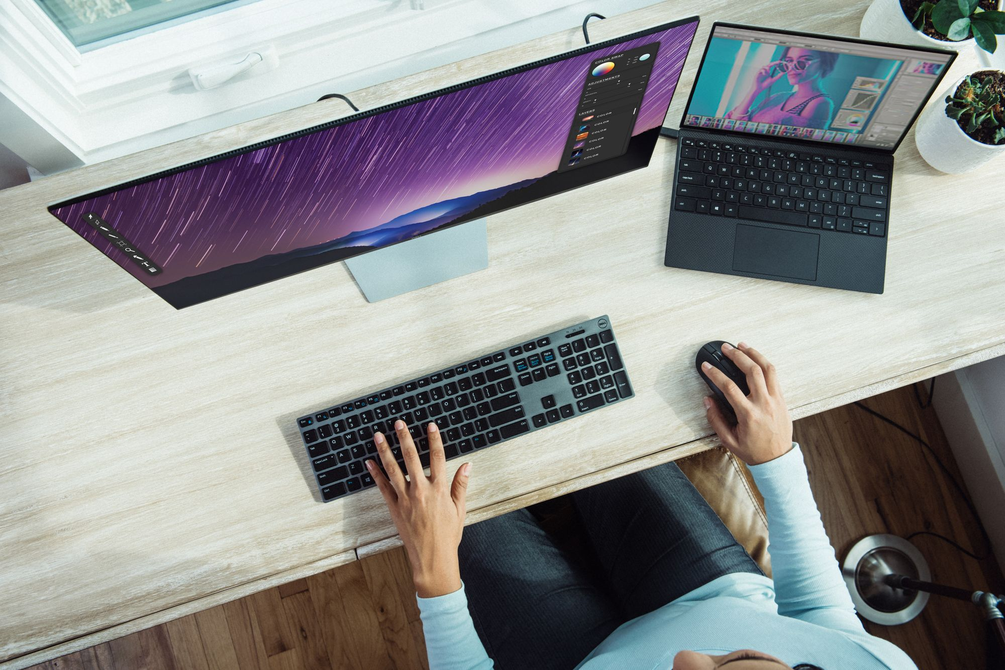 Woman working on large monitor doing UI design