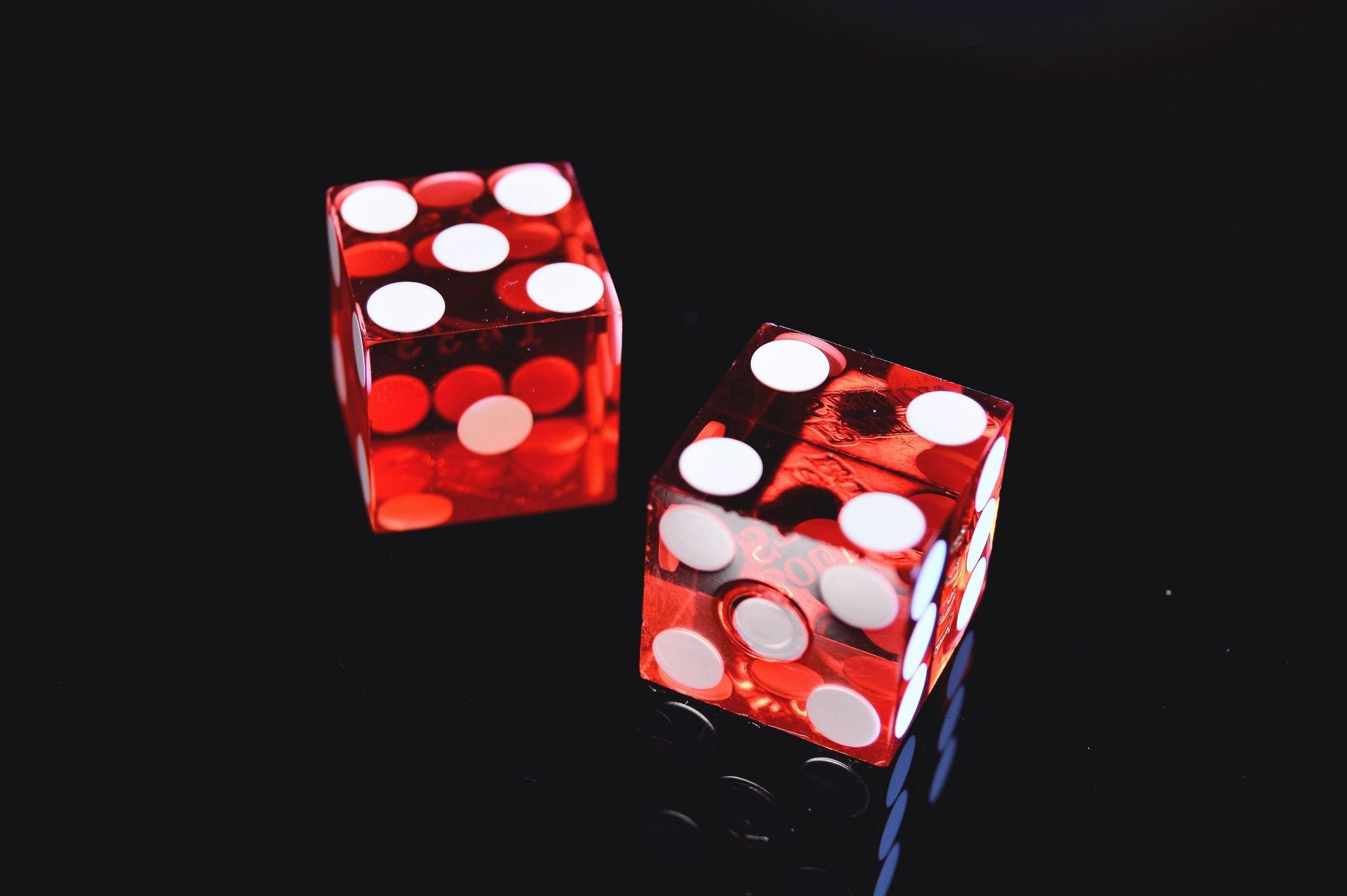 Two red dice (5 and 4)